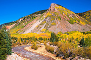 Fall color along Mineral Creek under Red Mountain Pass, San Juan National Forest, Colorado USA