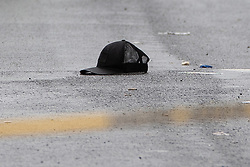 © Licensed to London News Pictures . 12/08/2018. Manchester , UK . A baseball cap in the road . Police have closed off Claremont Road in Moss Side after a shooting overnight during the annual Caribbean Carnival celebrations . Ten people are in hospital . Photo credit : Joel Goodman/LNP