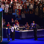 """Helped by Debbie Wasserman Schultz, former Arizona Congresswoman Gabrielle """"Gabby"""" Giffords walk on stage to lead the DCNC audience in the Pledge of Allegiance at the 2012 convention"""