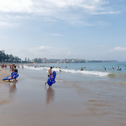 People enjoying the beach in Manly Beach during Australia Day. Manly Beach