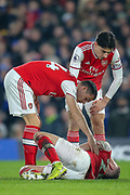 Arsenal defender Shkodran Mustafi (20) on the ground following a challenge during the Premier League match between Chelsea and Arsenal at Stamford Bridge, London, England on 21 January 2020.
