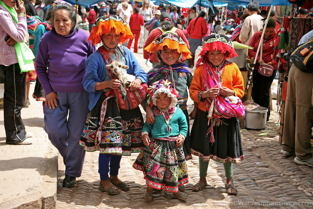 Americas, South America, Peru, Pisac. A local Quechua family poses and waits for handouts at Pisac market.