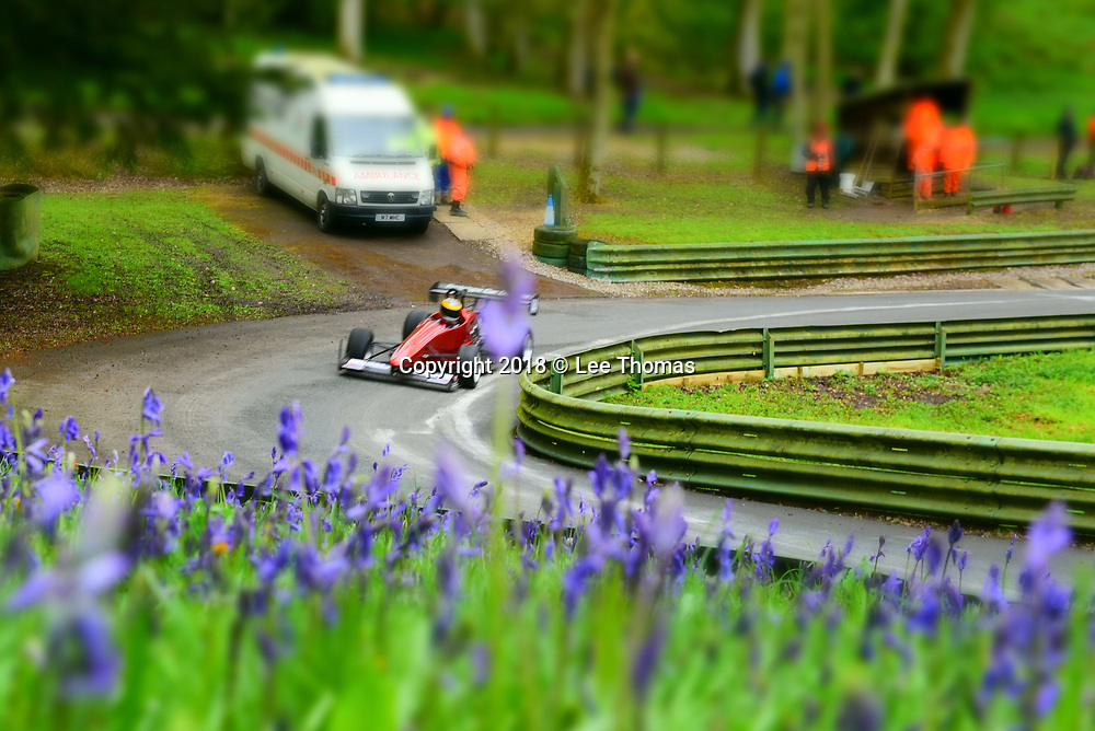 Prescott Hill, Gotherington, Cheltenham, Gloucestershire, UK. 29th April 2018.  Pictured:  Competitors tackle Prescott Hill. A tilt & shift lens effect has been applied to the image to give an impression of miniaturism.  /  Some of the fastest hillclimb cars in the country compete in the opening round of the UK's premier championships at the historic Prescott Hill in Gloucestershire, home of the UK's Bugatti Owners' Club.  The two day event features the opening rounds of the British & Midland Hillclimb Championships as well as rounds for the Bugatti Owners' Club (BOC) New Barn Roadgoing and the Aldon Classic Championships. The weekend meeting also entertained hundreds of spectators with an appearance from the National Hill Climb Association (NHCA) motorcycles, several with attached sidecars.  //Lee Thomas, Tel. 07784142973. Email: leepthomas@gmail.com  www.leept.co.uk (0000635435)