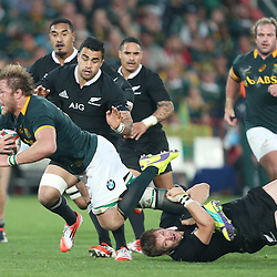 JOHANNESBURG, SOUTH AFRICA - OCTOBER 04: Duane Vermeulen of South Africa is tckled by Richie McCaw (captain) of New Zealand during The Castle Rugby Championship match between South Africa and New Zealand at Ellis Park on October 04, 2014 in Johannesburg, South Africa. (Credit Steve Haag/Gallo Images)
