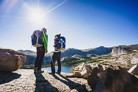 Above it all. Backpackers Chris Call and Kailtyn Honnold soak up the view of Stough Creek Basin, Wind River Range, Wyoming.