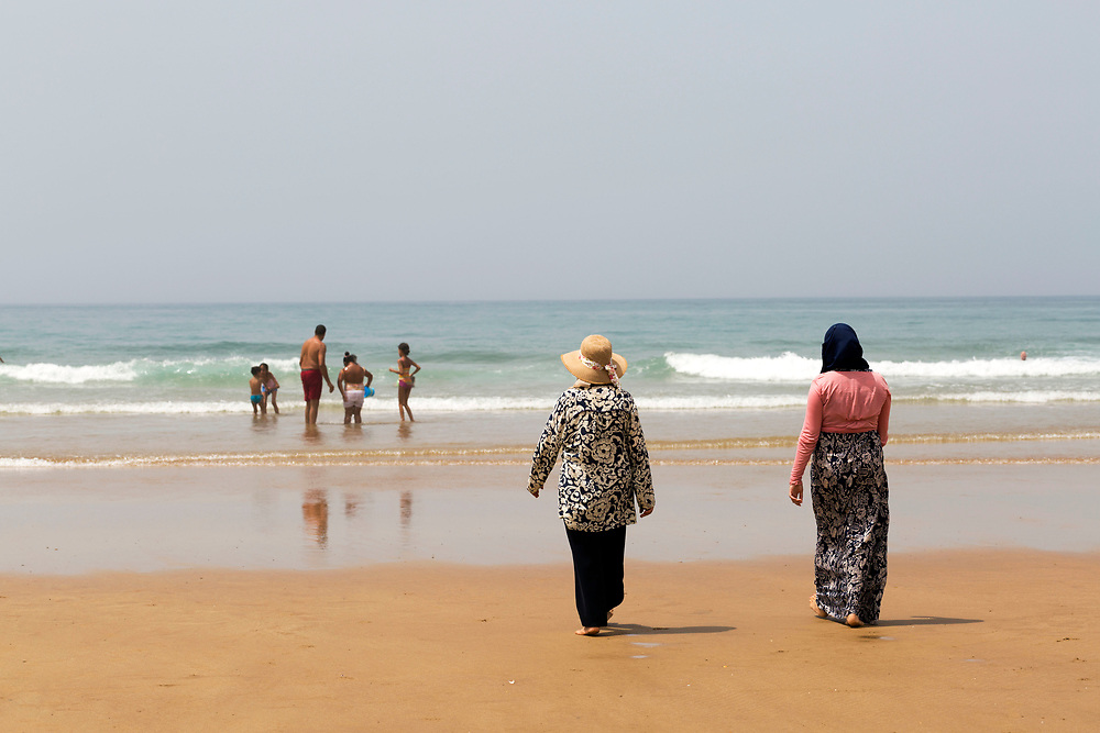 Paradise Beach, Asilah, Morocco, 2015-08-09.<br /><br />Paradise may be somewhat of an over statement, but the beach 2km south of Asilah is worth a visit. <br /><br />Collective taxis run back and forth throughout the day from nearby the Banque Populaire in the centre of Asilah and return back to town from the beach around sunset. <br /><br />Sharing a collective taxi is an interesting adventure in itself, as you pass by unspoilt areas of Morocco's rugged coastline. <br /><br />Known locally as 'Rmilate', the beach is packed full of tourists during the summer months and is best visited off season, when you can expect to have a large space to yourself. <br /><br />Numerous cabin hut restaurants line the base of the cliffs enclosing the beach, serving up freshly grilled sardines, moroccan salads and fish tagines.<br /><br />This beach is much more clean and wild than the main beach strip adjacent to the main town of Asilah. It's worth taking the short collective taxi ride out to this beach when seeking a day out by the seaside rather than camping on the main Asilah beach.