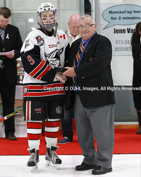 TRENTON, ON  - MAY 6,  2017: Canadian Junior Hockey League, Central Canadian Jr. &quot;A&quot; Championship. The Dudley Hewitt Cup. Championship game between Trenton Golden Hawks and the Georgetown Raiders. Hockey Canada Director Mr.Ed Pupich presents the player of the game award to Jordan Crocker #9 of the Georgetown Raiders.<br /> (Photo by Tim Bates / OJHL Images)