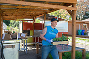 Stacey Givens of the Side Yard Farm & Kitchen in the Cully Neighborhood of Portland, OR adapt to Covid-19 social distancing rules by offering an online store. The store includes freshly harvested vegetables and herbs, homemade sauces and gnocci, seed packets, starts and other add ons from local makers.
