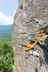 Will Tuttle rappelling after climbing Square Ledge in New Hampshire's White Mountains.