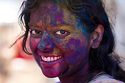 Indian woman celebrating annual Hindu Holi festival of colours with powder paints in Mumbai, formerly Bombay, Maharashtra, India