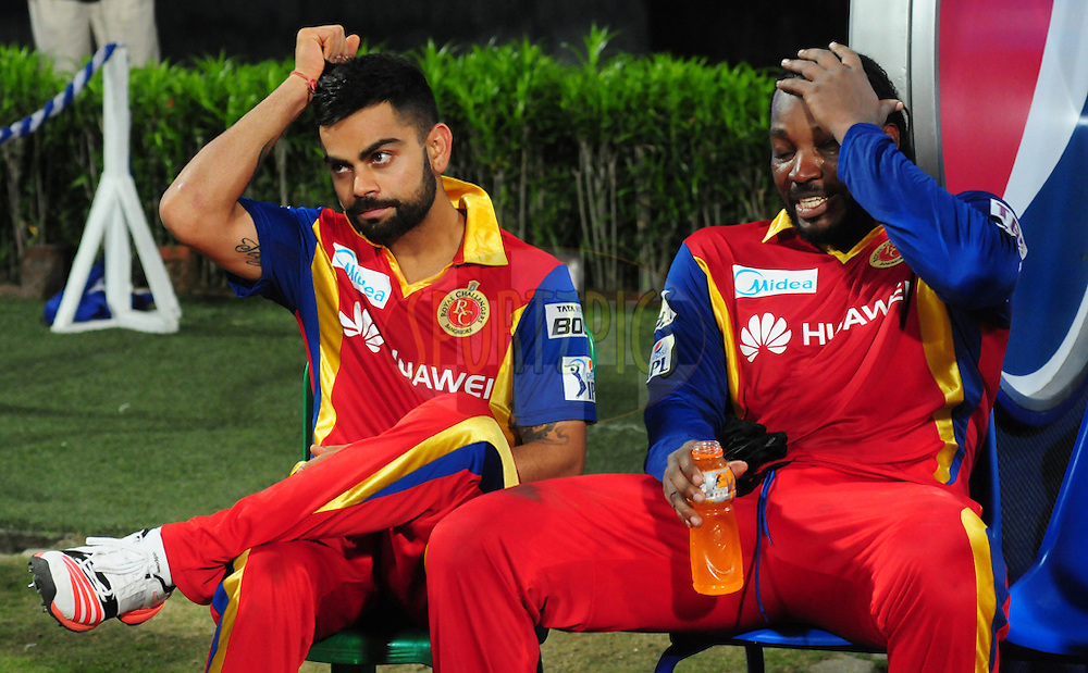 Virat Kohli and Chris gayle of the Royal Challengers Bangalore  after match 5 of the Pepsi IPL 2015 (Indian Premier League) between The Kolkata Knight Riders and The Royal; Challengers Bangalore held at Eden Gardens Stadium in Kolkata, India on the 11th April 2015.<br /> <br /> Photo by:  Arjun Panwar / SPORTZPICS / IPL