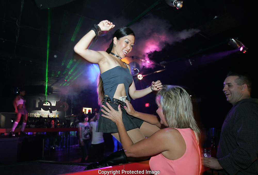A Liquid dancer gets a tip from a customer on a recent Saturday night....Liquid Bar.1100 N. High St., .Short North