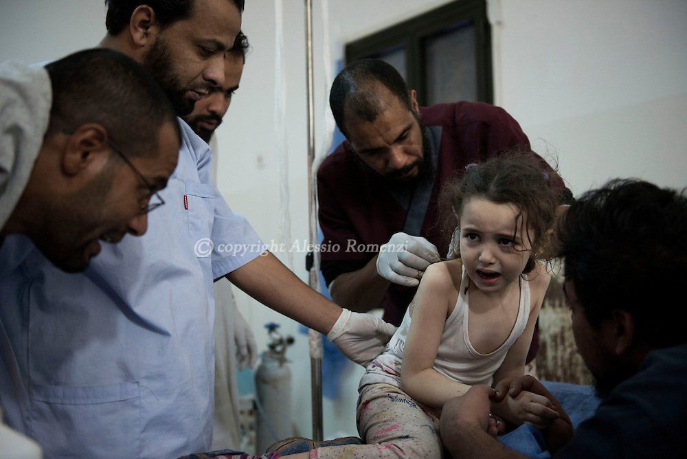 Libya, Sirte: At a field hospital in Sirte doctors try to distract a child while another doctor treats a wound she has on the shoulder.<br /> The child was under evident shock and has been taken at the field hospital right after then fighters of the Libyan forces affiliated to the Tripoli government took her from the area under ISIS control in Sirte. Alessio Romenzi
