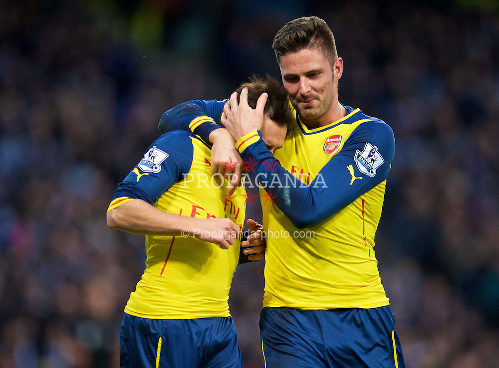 MANCHESTER, ENGLAND - Sunday, January 18, 2015: Arsenal's Santi Cazorla celebrates scoring the first goal against Manchester City from the penalty spot with team-mate Oliver Giroud during the Premier League match at the City of Manchester Stadium. (Pic by David Rawcliffe/Propaganda)
