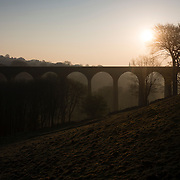 The Sun rising behind Thornton Viaduct, as the spell of warm spring weather continues. Thornton Viaduct was built in the 1870s as part of the railway line between Bradford Halifax and Keighley.