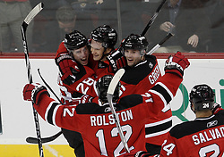 Dec 16, 2009; Newark, NJ, USA; New Jersey Devils left wing Patrik Elias (26) celebrates his game winning goal with his teammates during the third period of their game against the Montreal Canadiens at the Prudential Center. The Devils won 2-1.