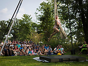 An aerial silk artist from the Clean Lakes Circus performs during the Makeshift Festival at Tenney Park in Madison, Wisconsin, Sunday, Aug. 12, 2018.