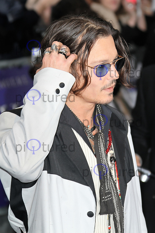 LONDON - MAY 09: Johnny Depp attends the European Film Premiere of 'Dark Shadows' at the Empire Cinema, Leicester Square, London, UK. May 09, 2012. (Photo by Richard Goldschmidt)