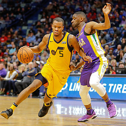 Feb 5, 2018; New Orleans, LA, USA; Utah Jazz guard Rodney Hood (5) drives past New Orleans Pelicans guard Ian Clark (2) during the second half at the Smoothie King Center. The Jazz defeated the Pelicans 133-109. Mandatory Credit: Derick E. Hingle-USA TODAY Sports