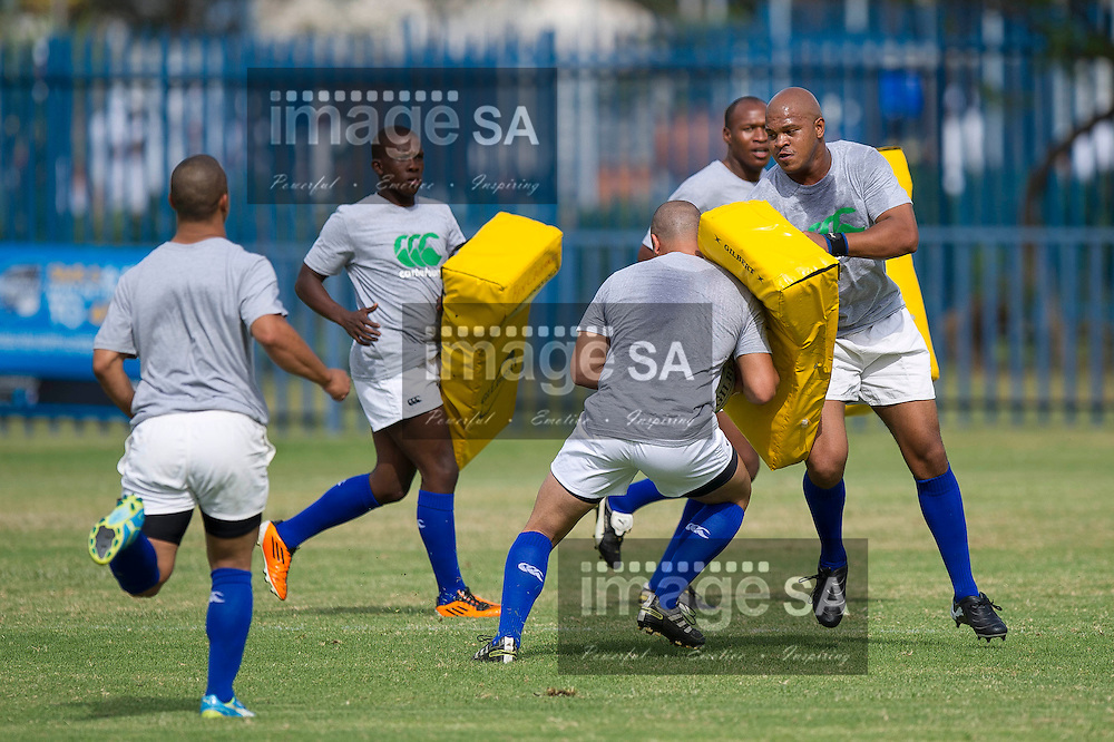 RUSTENBURG, SOUTH AFRICA - SATURDAY MARCH 2 2013,  Players warming up before the match during match 21 of the Cell C Community Cup rugby match between Rustenburg Impala and Bloemfontein Crusaders held at the Rustenburg stadium..Photo by ImageSA