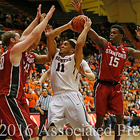 Oregon State's Malcolm Duvivier, center, drives on the lane on Stanford's Michael Humphrey, left, Cameron Walker, second from left, and Marcus Allen, right, in the first half of an NCAA college basketball game, in Corvallis, Ore., on Wednesday, Jan. 6, 2016. AP Photo/Timothy J. Gonzalez)