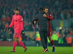 LIVERPOOL, ENGLAND - Wednesday, February 27, 2019: Liverpool's manager Jürgen Klopp embraces two goal hero Virgil van Dijk (R) as goalkeeper Alisson Becker (L) looks on at the final whistle during the FA Premier League match between Liverpool FC and Watford FC at Anfield. Liverpool won 5-0. (Pic by Paul Greenwood/Propaganda)