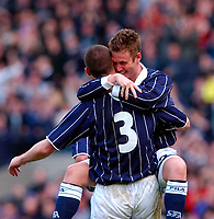 Photo. Richard Lane<br />Scotland v Iceland. Euro 2004 Qualifying Match at Hampden Park. 29/03/2003.<br />Lee Wilkie is congratulated on his goal by fellow scores, Kenny Miller.