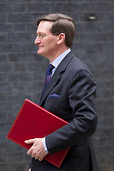 © Licensed to London News Pictures. 18/03/2014. London, UK. The Attorney General, Dominic Grieve, arrives for a meeting of the British cabinet on Downing Street in London today (18/03/2014). Photo credit: Matt Cetti-Roberts/LNP