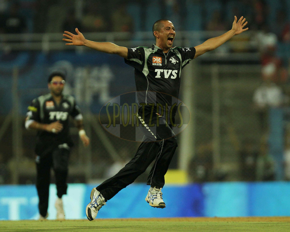 Pune Warriors player Alfonso Thomas celebrates after getting a wicket during  match 10 of the Indian Premier League ( IPL ) Season 4 between the Pune Warriors and the Kochi Tuskers Kerala held at the Dr DY Patil Sports Academy, Mumbai India on the 13th April 2011..Photo by BCCI/SPORTZPICS