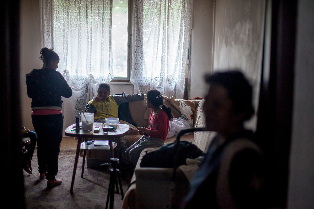 """Milena with her daughters and her mother Bozena (right). The family moved into another and final compensatory flat at Lunik IX after their first building (""""Hrebenova 34-36"""") was demolished by the city of Kosice in August 2014, the second flat was not in a appropriate condition."""
