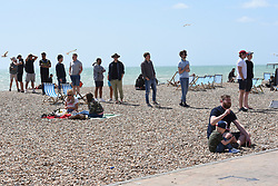 © Licensed to London News Pictures. 24/05/2020. Brighton, UK. Members of the public queue for the toilets in hot weather on Brighton seafront in East Sussex, during lockdown to prevent to spread of COVID-19.  Photo credit: Liz Pearce/LNP