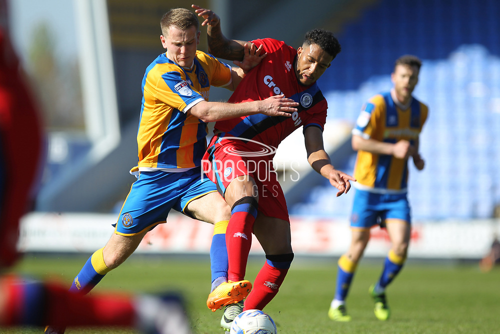 Nathaniel Mendez-Laing is challenged  during the EFL Sky Bet League 1 match between Shrewsbury Town and Rochdale at Greenhous Meadow, Shrewsbury, England on 8 April 2017. Photo by Daniel Youngs.