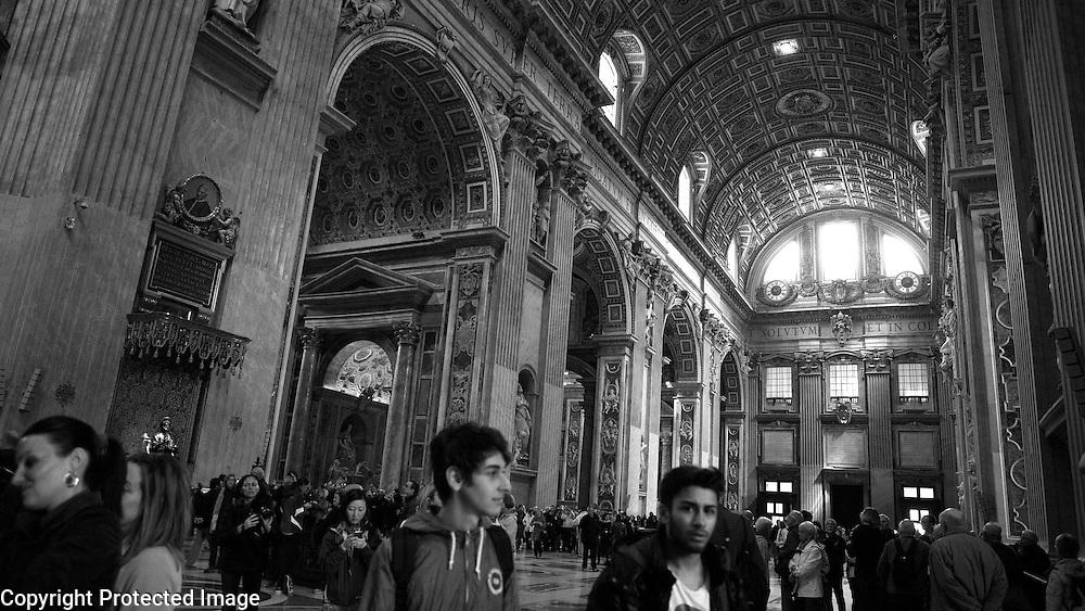 Visitors move through Saint Peter's Basilica.