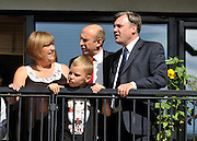 SOUTH BERMONDSEY, LONDON:  Gillian Warren and Son Alfie aged 9 chat to John Healey and Ed Balls on the balcony of their home. Ed Balls, Labour Leadership candidate joins shadow housing minister John Healey and  shadow work and pensions secretary Yvette Cooper  during a visit to a housing development, The Falcon Works development, in central London on 31 August 2010. STEPHEN SIMPSON..