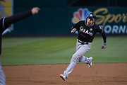 Miami Marlins center fielder Christian Yelich (21) rounds third base to score a run against the Oakland Athletics at Oakland Coliseum in Oakland, Calif., on May 23, 2017. (Stan Olszewski/Special to S.F. Examiner)