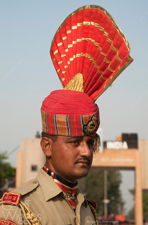 Member of India's Border Security Force BSF in dress uniform attending the India Pakistan gate closing ceremony at Wagah Border, Punjab, India.