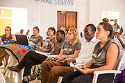 Volunteers watching the scholl children debate at the VSO ICS Community Action Day CAD held for local members of the community in Y2K Hall Lindi, Lindi region. Tanzania.