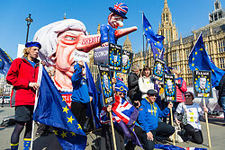 Anti-Brexit and People's Vote campaigners from SODEM pose with their latest placards deriding the politicians at the centre of the Brexit impasse, in Old Palace Yard outside the Houses of Parliament in Westminster. London, April 01 2019.