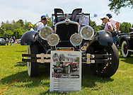 Old Westbury, New York, U.S. - June 1, 2014 - Winner of the Best in Show for Post War is a one-of-a-kind 1926 Stutz, owner STEVEN GITTELMAN of HUNTINGTON, at the Antique and Collectible Auto Show held on the historic grounds of elegant Old Westbury Gardens in Long Island, and sponsored by Greater New York Region AACA Antique Automobile Club of America. The poster in front of car explains the unique car custom was built for Grace and General Cornelius Vanderbilt III, and is the only known one with a Victoria Top.
