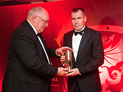 CARDIFF, WALES - Monday, October 6, 2014: FAW President Trefor Lloyd-Hughes presents a gift to manager Jarmo Matikainen at the FAW Footballer of the Year Awards 2014 held at the St. David's Hotel. (Pic by David Rawcliffe/Propaganda)