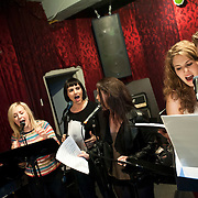 """December 5, 2013 - New York, NY: Members of the NBC musical drama television series """"Smash"""", and their ensemble and band, including, from left, Benjamin Rauhala (piano), Julia Mattison, Molly Hager, Carrie Manolakos, Monet Julia Sabel, and Eric Michael Krop rehearse at Smash Studios at 36th Street in Manhattan on Thursday afternoon in preparation for their cabaret performance of """"HIT LIST,"""" which will premiere Sun, Dec 8 at 54 Below. CREDIT: Karsten Moran for The New York Times"""