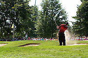 Jul 31, 2005; Grand Blanc, MI, USA; Only a great effort on the back nine got Tiger Woods back second place after the front nine continued to give him problems.  On the second hole he first found the trees on the right then the greenside bunker shown here during final round play at the 2005 Buick Open at the Warwick Hills Golf and Country Club. Copyright © 2005 Kevin Johnston