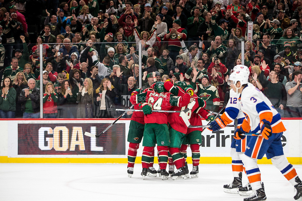 Dec 29, 2016; Saint Paul, MN, USA; Minnesota Wild defenseman Jared Spurgeon (46) celebrates his goal with teammates during the second period against the New York Islanders at Xcel Energy Center. Mandatory Credit: Brace Hemmelgarn-USA TODAY Sports