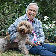 Portrait and photographs of actor and author Henry Winkler at his home in Brentwood, California with his favorite 1 year old Labradoodle, Sadie.
