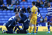 Michael Morrison (4) of Reading recieves treatment during the EFL Sky Bet Championship match between Reading and Preston North End at the Madejski Stadium, Reading, England on 19 October 2019.