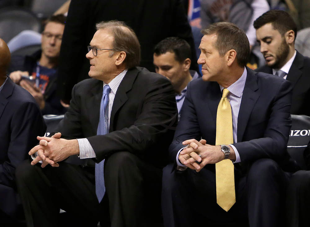 New York Knicks head coach Jeff Hornacek and Kurt Rambis in the first half during an NBA basketball game against the Phoenix Suns, Friday, Jan. 26, 2018, in Phoenix. (AP Photo/Rick Scuteri)