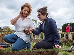 © Licensed to London News Pictures. 13/10/2018. Winchcombe, Gloucestershire, UK. Sudeley Castle. Historical novelist Dr PHILIPPA GREGORY examines a piece of masonry with archaeologist Harriet Tatton. The team of archaeologists from DigVentures hope to unearth a long-lost Tudor garden at Sudeley Castle this weekend. Philippa, who's well-known works include The Other Boleyn Girl and The White Queen, started her research into Sudeley Castle whilst working on a novel about Katherine Parr. For nearly 1,000 years, Sudeley Castle has hosted some of England's most famous monarchs including Henry VIII. It is also where Katherine Parr, Henry's last wife, later lived and was finally laid to rest. A recent geophysical survey at Sudeley revealed the ghostly outline of a long-lost Tudor garden, with traces of what could have been a banqueting house in the same area where pieces of Tudor masonry were found in the 19th century. Now experts say it is time to investigate further. The dig will take place at this Saturday and Sunday, October 13 and 14, and is thought to be the most significant archaeological investigation since the discovery of Roman villas on the estate in Victorian times. A specialist team from social archaeology company, DigVentures, will begin an investigation of the site, which aims to 'ground-truth' the geophysics results. They hope to reveal some of the Tudor secrets that remain hidden underground at the castle. Following the popular landscaping movement inspired by Capability Brown, many Tudor gardens were lost, and this is perhaps just one of only two in England where the original paths remain visible. Photo credit: Simon Chapman/LNP