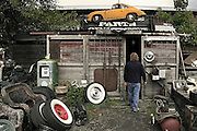 Car Photography from Automotive Photographer Randy Wells, Image of a man entering an auto parts storage building in McMinneville, Oregon, Pacific Northwest