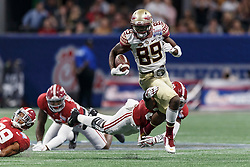 Florida State Seminoles wide receiver Keith Gavin (89) carries the ball past Alabama Crimson Tide linebacker Shaun Dion Hamilton (20) during the Chick-fil-A Kickoff NCAA football game on Saturday, September 2, 2017, in Atlanta. (Paul Abell via Abell Images for Chick-fil-A Kickoff Game)