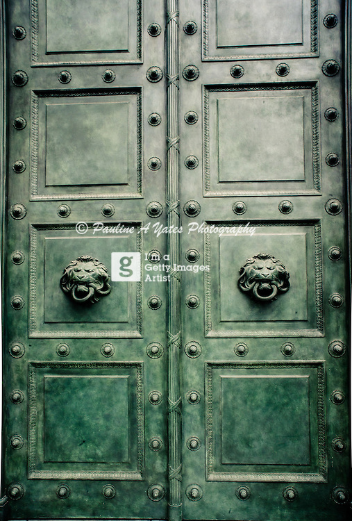 Green doors of the Palais De Justice in Paris, France